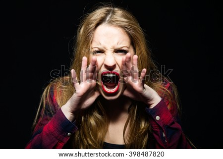 Portrait of beautiful young woman screaming. Isolated. - stock photo