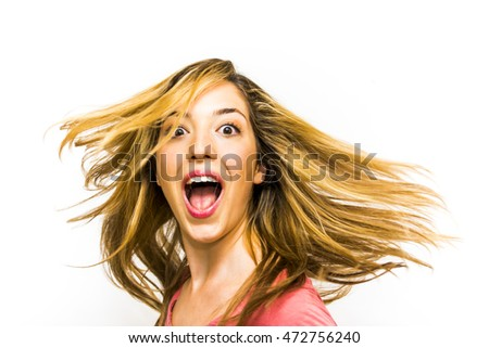 Portrait of Beautiful Young Woman Shaking Her Hair And  Screaming Over White Background