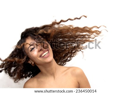 Portrait of Beautiful Young Woman Shaking Her Hair Over White Background