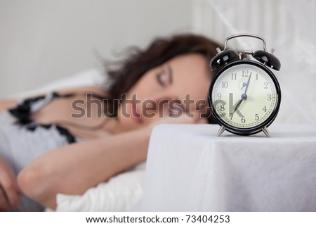 Portrait of beautiful young woman sleeping in bed at home.