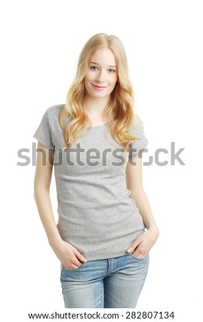 Portrait of beautiful young woman standing against white background while looking at camera and smiling.