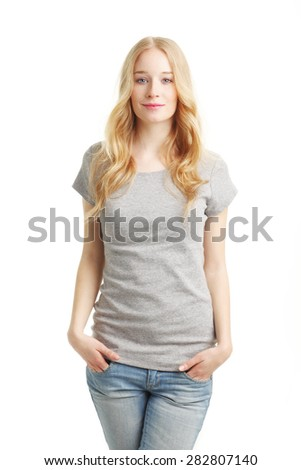 Portrait of beautiful young woman standing against white background while looking at camera and smiling. - stock photo