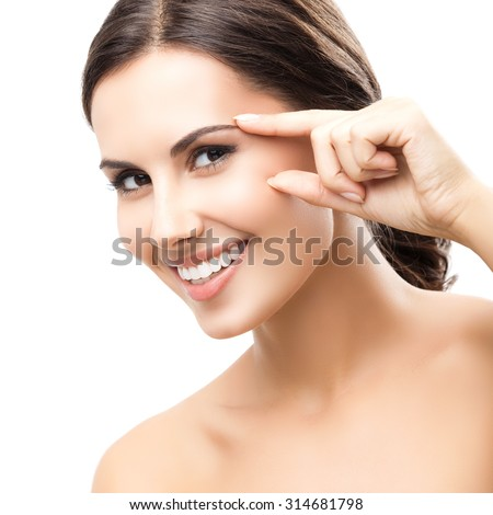 Portrait of beautiful young woman touching skin or applying cream, isolated over white background - stock photo