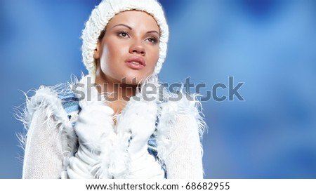 Portrait of beautiful young woman wearing fashion winter clothing - stock photo