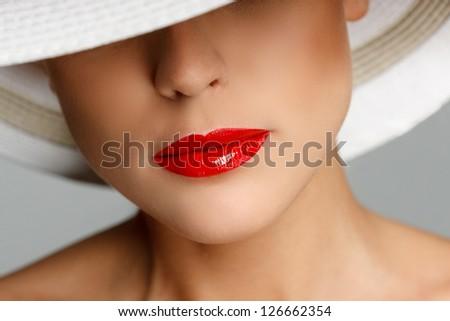 Portrait of beautiful young woman wearing straw hat - stock photo