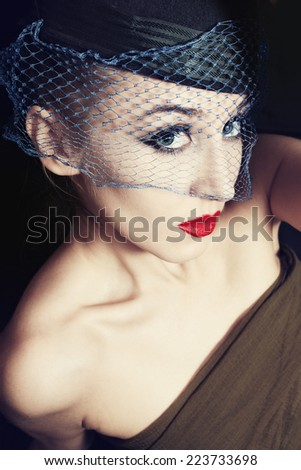 Portrait of beautiful young woman wearing veil and hat. retro Style