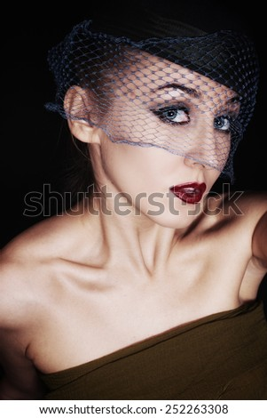 Portrait of beautiful young woman wearing veil and hat. retro Style - stock photo