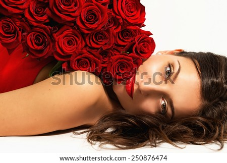 Portrait of beautiful young woman with a bouquet of flowers - stock photo