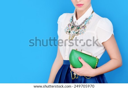 Portrait of beautiful young woman with bag.Fashion photo - stock photo