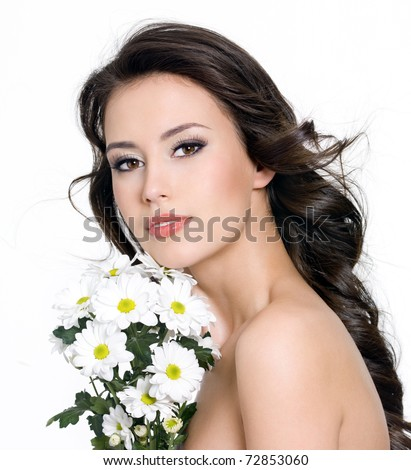 Portrait of beautiful young woman with  bouquet of flowers - white background