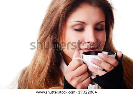 portrait of beautiful young woman with cup of coffee