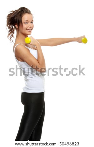 Portrait of beautiful young woman with dumbbells.