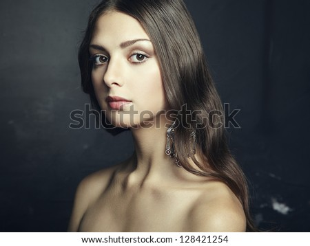 Portrait of beautiful young woman with earring. Fashion photo - stock photo