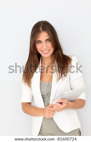 Portrait of beautiful young woman with electronic tablet