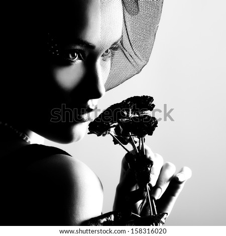 portrait of beautiful young woman with flowers, black and white retro stylization - stock photo