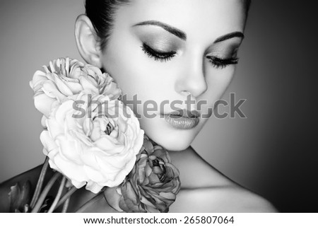 Portrait of beautiful young woman with flowers. Perfect makeup. Perfect skin. Fashion photo. Black and white - stock photo