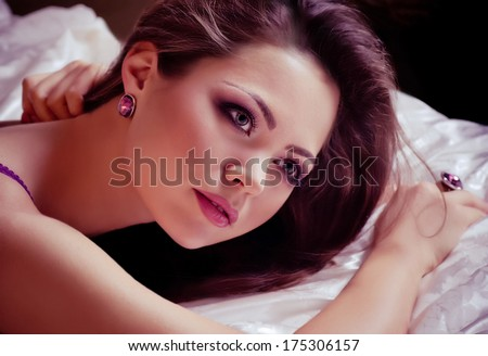 Portrait of beautiful young woman with golden jewelry