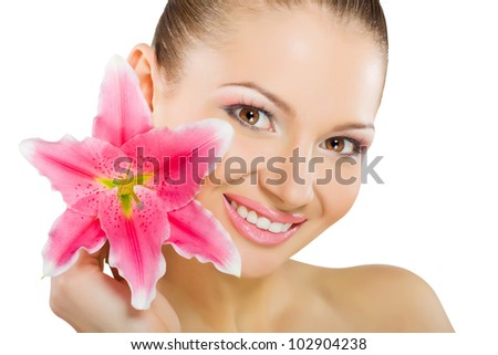 Portrait of beautiful young woman with healthy skin and with flower, isolated on white background