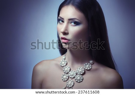 Portrait of beautiful young woman with jewelry - stock photo