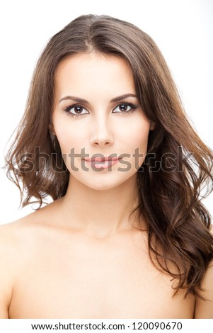 Portrait of beautiful young woman with long curly hair, isolated over white background