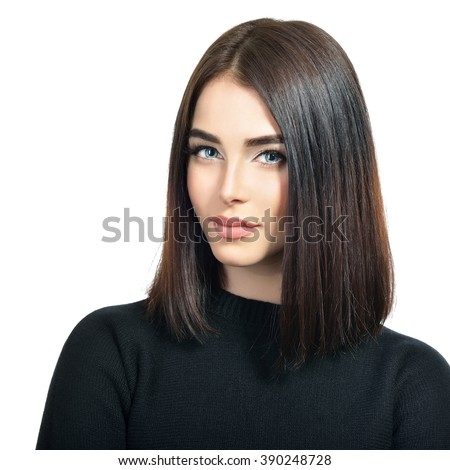 Portrait of beautiful young woman with long dark brown hair and black roll-neck sweater looking at camera over white background. Beauty face. Beauty woman.