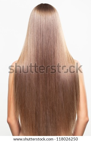 Portrait of beautiful young woman with long healthy hair - stock photo