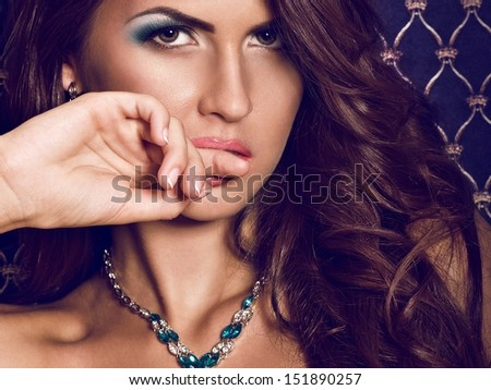 Portrait of beautiful young woman with makeup with jewelry precious decorations.