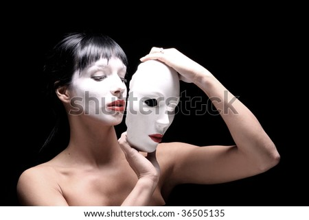 portrait of Beautiful young woman with mask - stock photo
