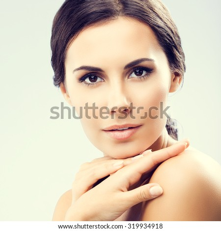 portrait of beautiful young woman with naked shoulders - stock photo