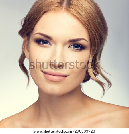 Portrait of beautiful young woman with naked shoulders. Beauty and health concept. - stock photo