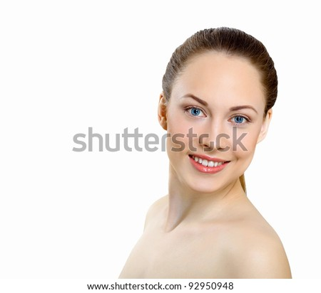 Portrait of beautiful young woman with natural look