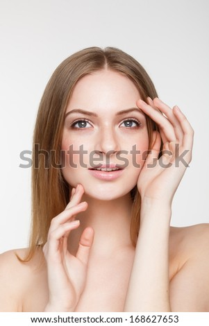 Portrait of Beautiful Young Woman with natural makeup. Fresh Clean Healthy Skin
