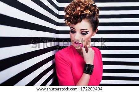 Portrait of beautiful young woman with professional party make up false eyelashes  - stock photo