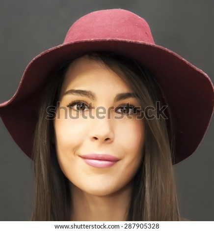 Portrait of Beautiful Young Woman With Red  Hat Over Black Background