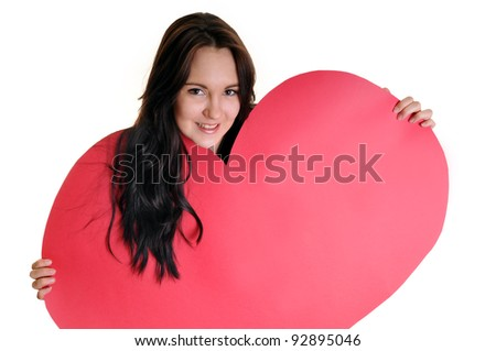 Portrait of beautiful young woman with red heart on white background