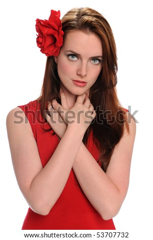 Portrait of beautiful young woman with red rose on hair - stock photo