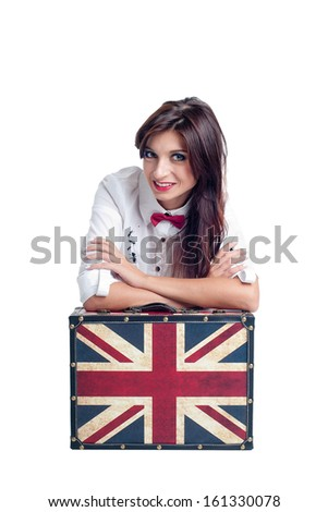 Portrait of beautiful young woman with suitcase with British flag, isolated on white background