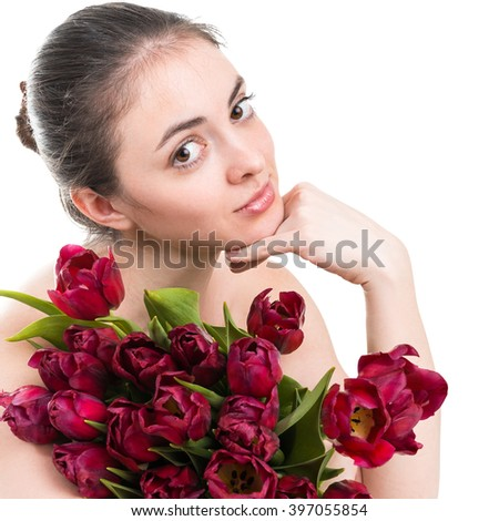 Portrait of beautiful young woman with tulips - stock photo