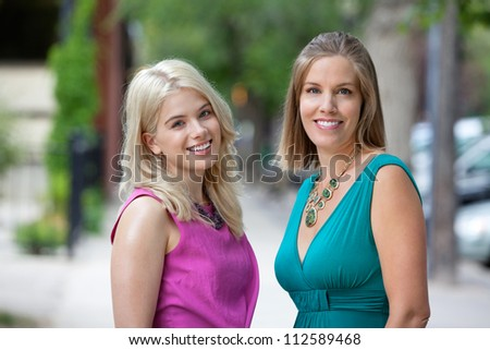 Portrait of beautiful young women in casuals smiling