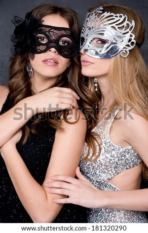 portrait of Beautiful young women in mysterious venetian mask. - stock photo
