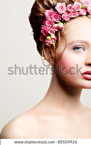Portrait of beauty bride with roses in hair