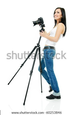 portrait of beauty brunette with camera on tripod - stock photo