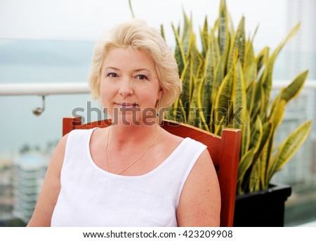 Portrait of beauty middle aged woman in the park - stock photo