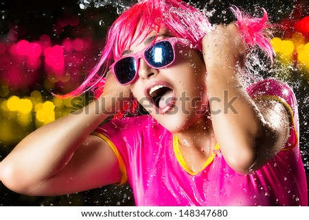 Portrait of beauty party girl with water splashes expressing happiness