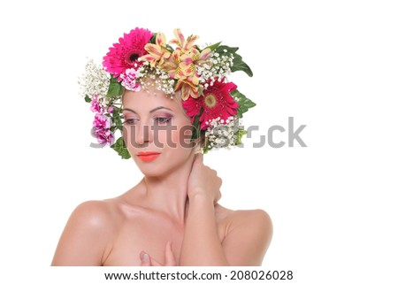 Portrait of beauty with a flowered head