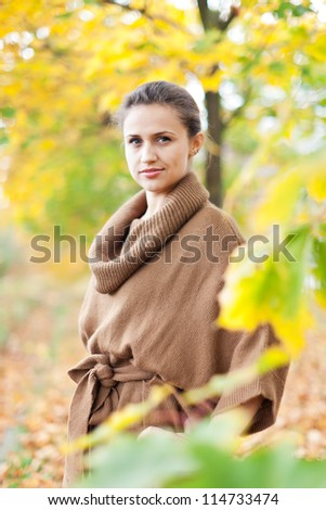 Portrait of beauty woman in september park - stock photo