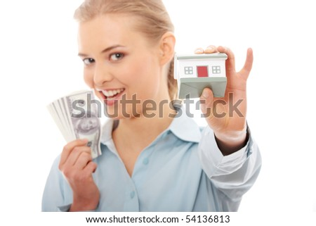 Portrait of beauty woman with money and toy house in hands, isolated on white