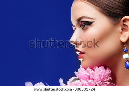Portrait of Beauty Woman with  peonies flowers. Cosmetics and cosmetology.
