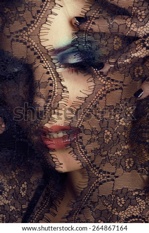 portrait of beauty young woman through lace close up - stock photo