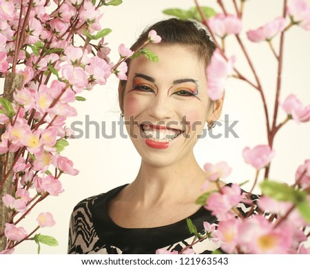 portrait of beauty young woman with flower close up like geisha make up